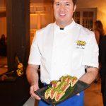 Head Chef of Kapow, Tim Nickey displays his offering of tuna poke tacos